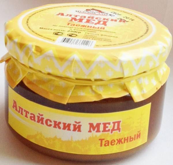 Фасованный таёжный мёд в стеклянной банке