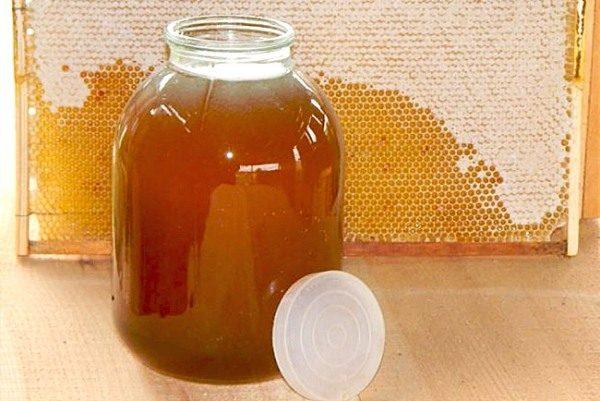 Мед разнотравье в банке и рамка с мёдом